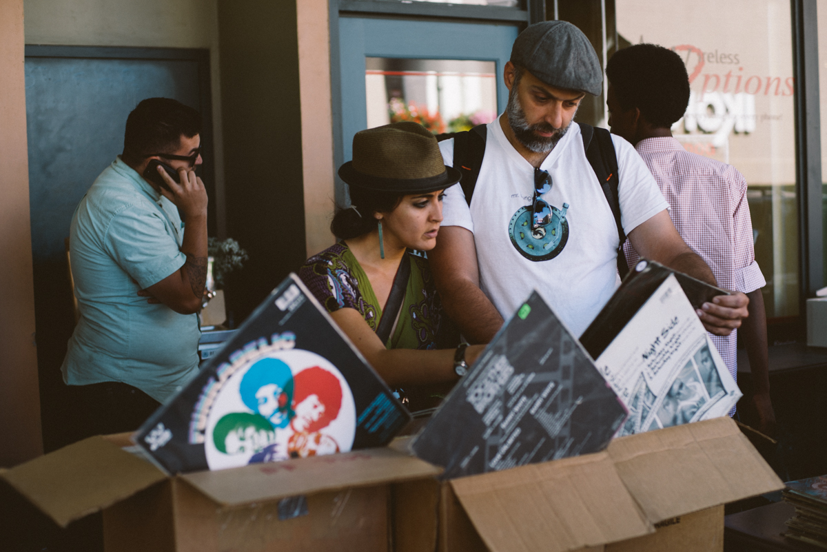 couple checking out records outside vintage shop