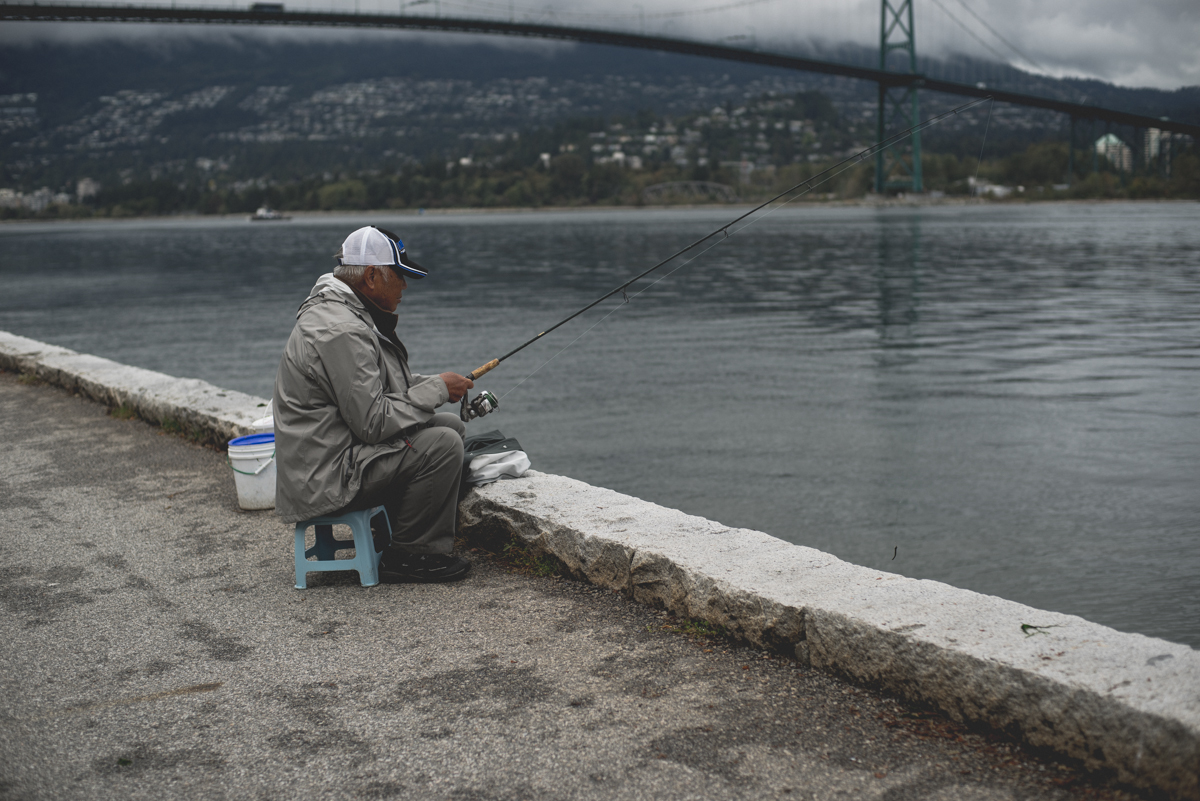 older gentleman fishing in vancouver