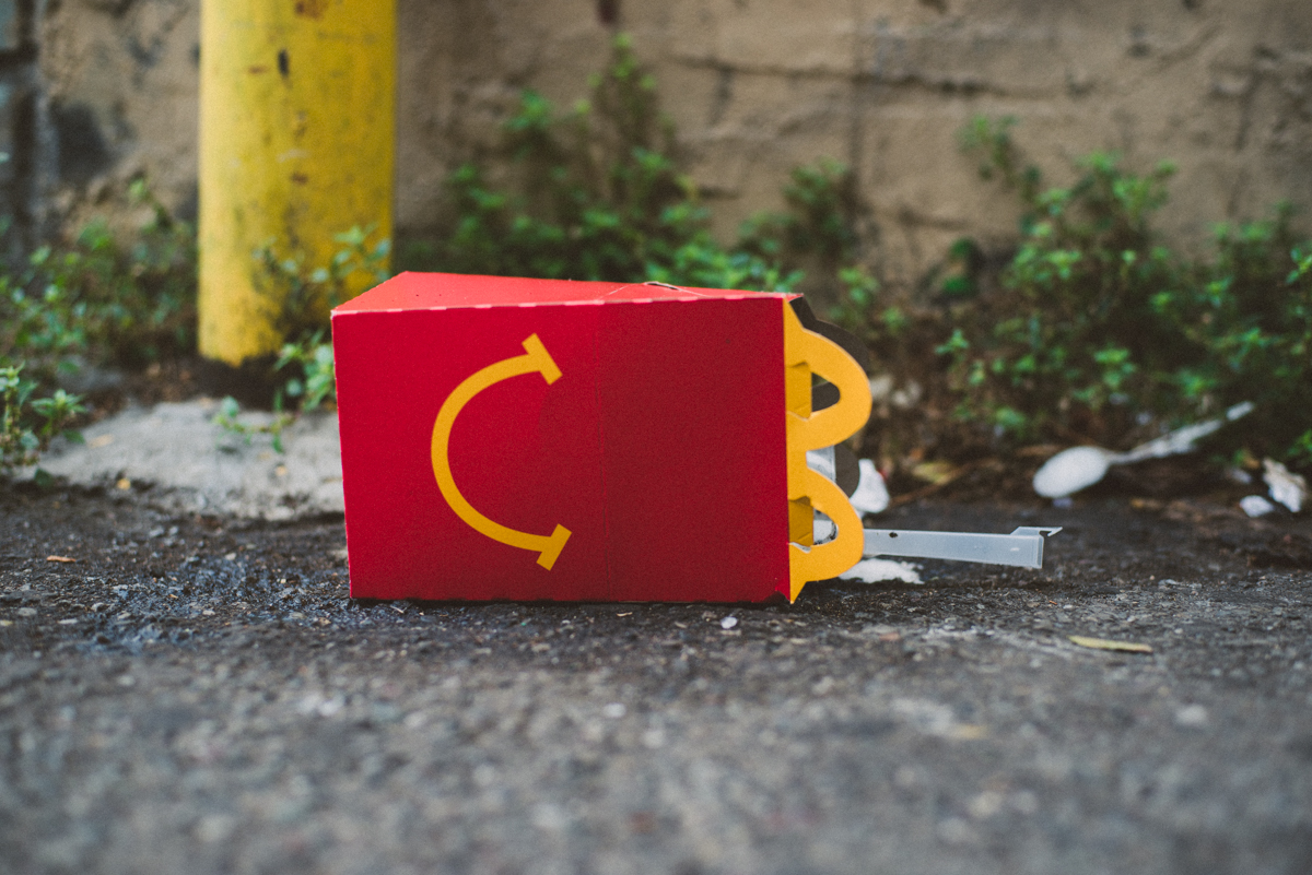mcdonalds happy meal box in a back sf alley