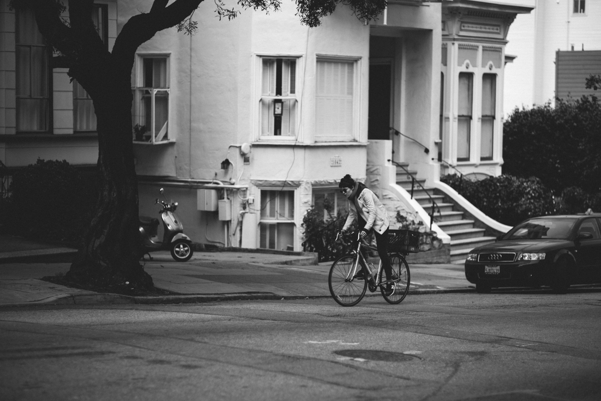 biker hustling up haight st in sf