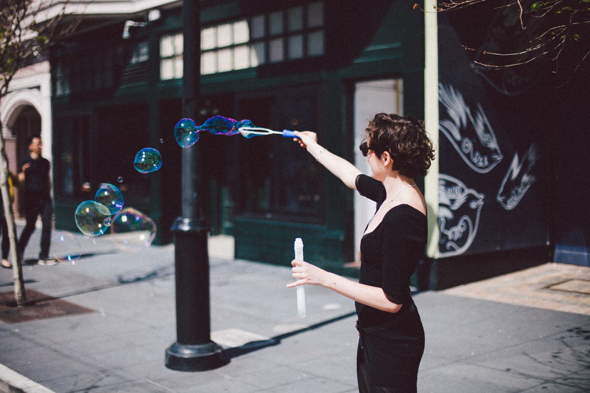 woman playing with bubbles